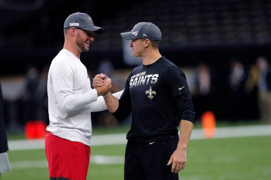 New Orleans Saints quarterback Drew Brees greets Tampa Bay Buccaneers quarterback Blaine Gabbert up before an NFL football game against the Tampa Bay Buccaneers in New Orleans, Sunday, Oct. 6, 2019. (AP Photo/Bill Feig)