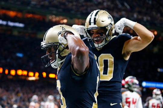 New Orleans Saints wide receiver Michael Thomas celebrates his touchdown reception with wide receiver Austin Carr (80) in the first half of an NFL football game against the Tampa Bay Buccaneers in New Orleans, Sunday, Oct. 6, 2019. (AP Photo/Butch Dill)