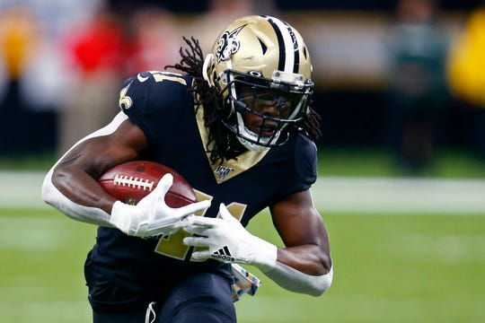 New Orleans Saints running back Alvin Kamara (41) carries in the first half of an NFL football game against the Tampa Bay Buccaneers in New Orleans, Sunday, Oct. 6, 2019. (AP Photo/Butch Dill)