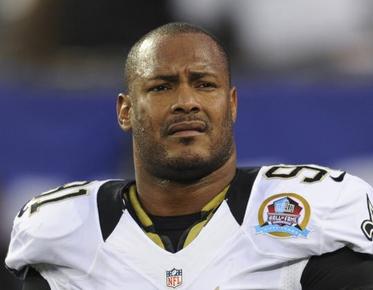 New Orleans Saints defensive end Will Smith appears before an NFL football game against the New York Giants in East Rutherford, N.J. in 2012.  Smith, who died in 2016, was posthumously inducted into team's Ring of Honor.