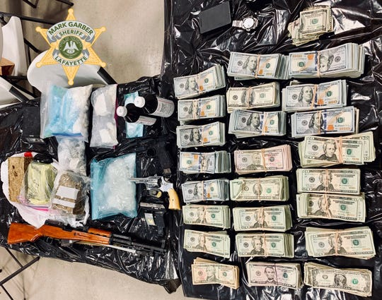 Police recovered a variety of drugs, firearms and $253,705 in cash from Oliver Martin's home while executing a search warrant.