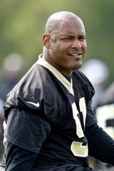 New Orleans Saints defensive end Will Smith (91) during organized team activities at the team's practice facility in 2012. Smith, who died in 2016, was posthumously inducted into team's Ring of Honor.