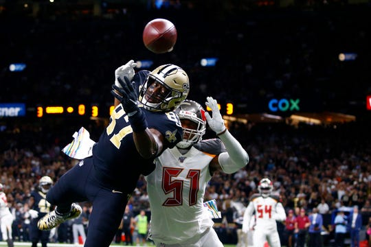 New Orleans Saints tight end Jared Cook (87) reaches in vain for a pass as Tampa Bay Buccaneers linebacker Kevin Minter (51) pursues in the first half of an NFL football game in New Orleans, Sunday, Oct. 6, 2019. (AP Photo/Butch Dill)