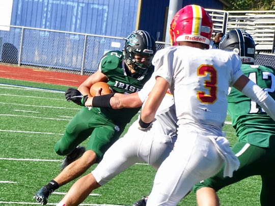 Fisher Catholic senior quarterback Kaden Starcher runs the ball against Worthington Christian on Saturday during the Irish's 31-21 loss.