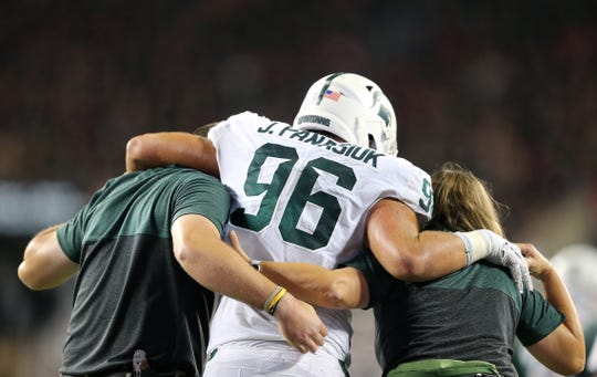 Oct 5, 2019; Columbus, OH, USA; Michigan State Spartans defensive end Jacub Panasiuk (96) leaves with an injury during the fourth quarter at Ohio Stadium. Mandatory Credit: Joe Maiorana-USA TODAY Sports