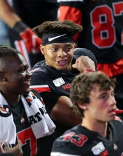 Oct 5, 2019; Columbus, OH, USA; Ohio State Buckeyes quarterback Justin Fields (1) celebrates with teammates after the game against the Michigan State Spartans at Ohio Stadium. Mandatory Credit: Joe Maiorana-USA TODAY Sports