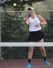 Ontario senior Lizzie Burson, shown in a match earlier this season, went 4-1 in the Division II sectional tennis tournament to earn a district berth.