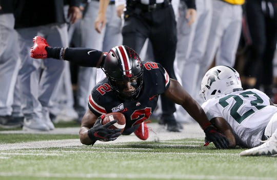 Ohio State tailback J.K. Dobbins had another huge game, rushing for 172 yards and a 67-yard touchdown in the Buckeyes' 34-10 win over Michigan State.
