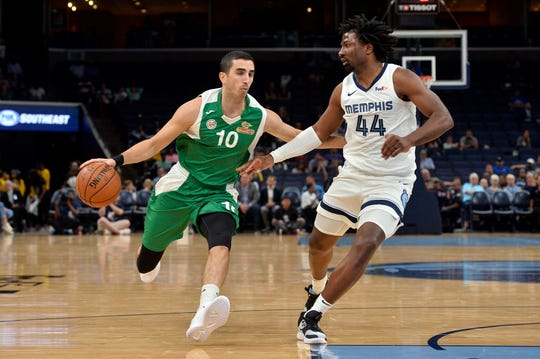 Maccabi Haifa point guard Guy Lavie (10) drives against Memphis Grizzlies forward Solomon Hill (44) during the second half of an exhibition NBA basketball game Sunday, Oct. 6, 2019, in Memphis, Tenn.