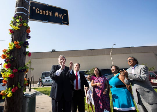"""An honorary street sign named """"Gandhi Way"""" is unveiled by the National Civil Rights Museum on Saturday, Oct. 5, 2019."""
