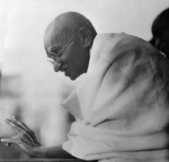 Mahatma Gandhi shown acknowledging cheers from the crowds which greeted him on his arrival after being released from prison in Poona, Jan. 20, 1931, Bombay, India. He was confined eight months.