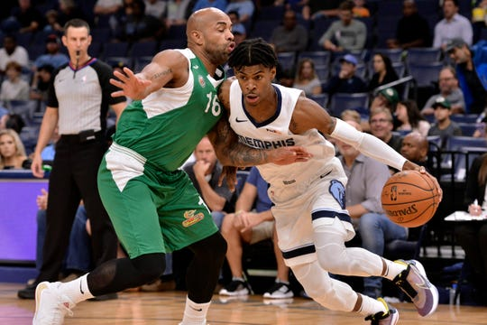 Memphis Grizzlies guard Ja Morant, right, controls the ball against Maccabi Haifa guard Gregory Vargas in the first half of an exhibition NBA basketball game Sunday, Oct. 6, 2019, in Memphis, Tenn.