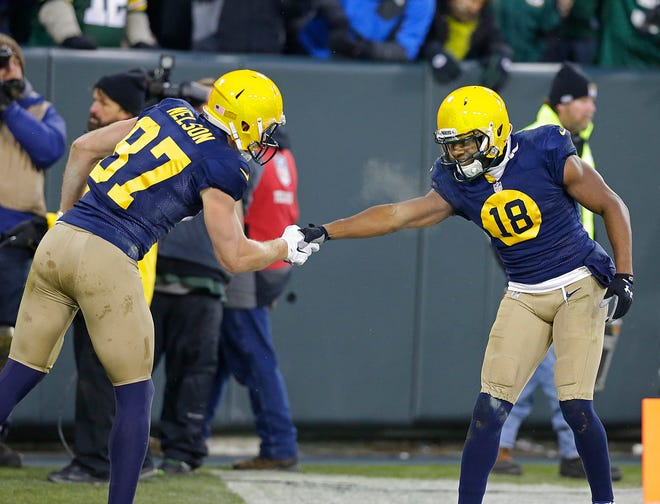 Former Packers wide receivers Jordy Nelson and Randall Cobb celebrate a touchdown in 2014.