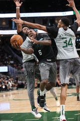 Eric Bledsoe tries to split defenders a the Bucks' open scrimmage at Sunday.