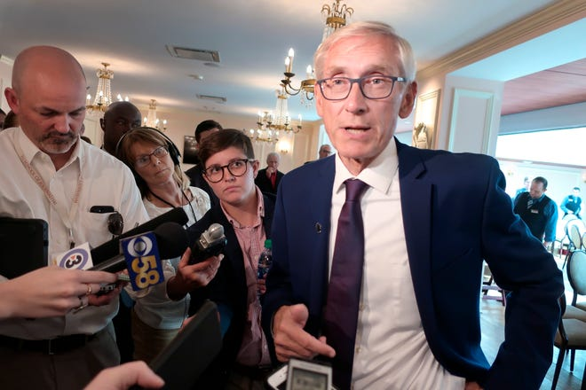 In this Sept. 24, 2019, file photo, Wisconsin Gov. Tony Evers speaks with reporters at an event in Madison.