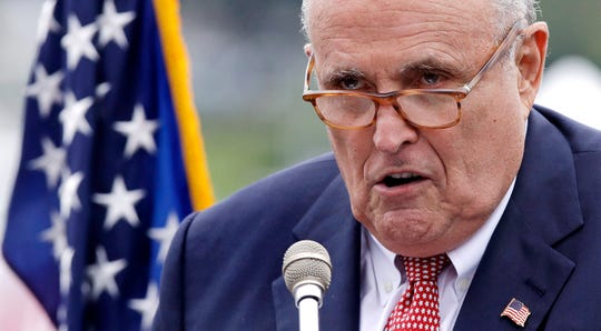 This Aug. 1, 2018, file photo shows Rudy Giuliani, an attorney for President Donald Trump, in Portsmouth, N.H. As Giuliani was pushing Ukrainian officials in the spring of 2019 to investigate one of Donald Trump's main political rivals, a group of individuals with ties to the president and his personal lawyer were also active in the former Soviet Republic.