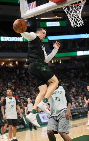Pat Connaughton tries to get control of a loose ball under the basket.