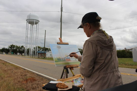 Robine Wright – an Ohio artist – has been at every Plein Air Paint Out since the very first. She painted the soon-to-be Pike Road Arts Center (under the water tower on Wallahatchie Road) during the 2018 Paint Out. The painting now hangs in the Arts Center.