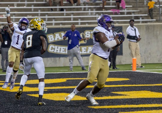 Alcorn linebacker Solomon Muhammad (49) snags an interception on a pass intended for ASU wide receiver Tyrek allen (8).