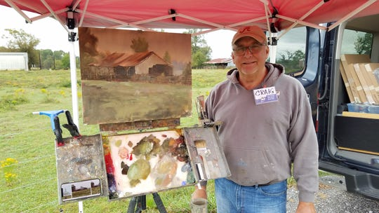 Artist Craig Reynolds beats the drizzly weather with a pop-up tent because all weather is art weather. Plein air painting focuses on capturing the details of the moment – light, shadows, and even cloudy skies. Reynolds took home the People's Choice Award at the 2018 Plein Air Paint Out.