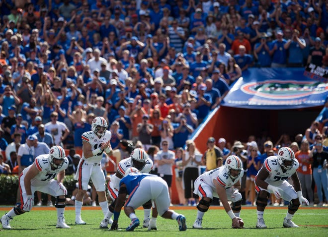 Auburn quarterback Bo Nix (10) lines up to snap the ball from center Kaleb Kim (54) at Ben Hill Griffin Stadium in Gainesville, Fla., on Saturday, Oct. 5, 2019. Florida defeated Auburn 24-13.