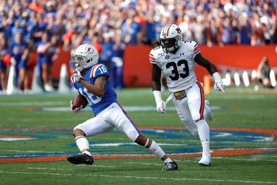 Florida wide receiver Freddie Swain (16) runs past Auburn linebacker K.J. Britt (33) for a touchdown on Saturday, Oct. 5, 2019, in Gainesville, Fla.