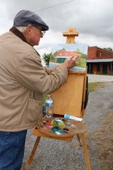 Artist Larry Stewart grew up going to the businesses that once flourished at the intersection of Pike and Meriwether Roads. Stewart paints the scenes of that historic town center.