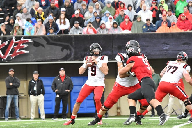 FILE -- Ball State quarterback Drew Plitt looks to pass during the Cardinals' game against Northern Illinois. Ball State defeated NIU.