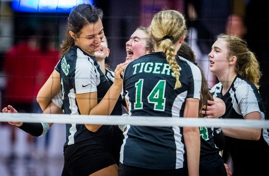 Yorktown celebrates after scoring a point against Wapahani during their championship game at Wapahani High School Saturday, Oct. 5, 2019.