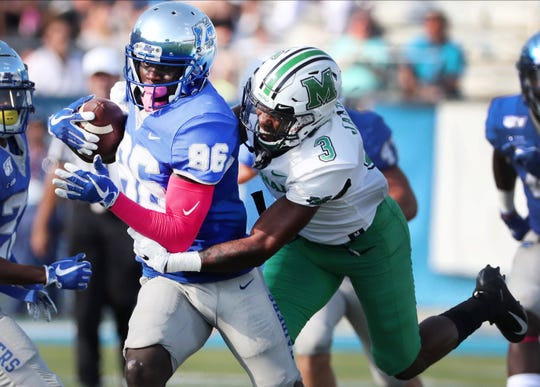 Marshall defensive back Chris Jackson (3) tackles MTSU wide receiver Jarrin Pierce (86) during their game Oct. 5.