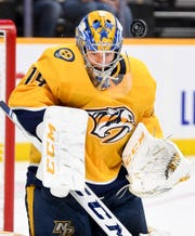 Predators goaltender Juuse Saros blocks a Red Wings shot during the second period Saturday.