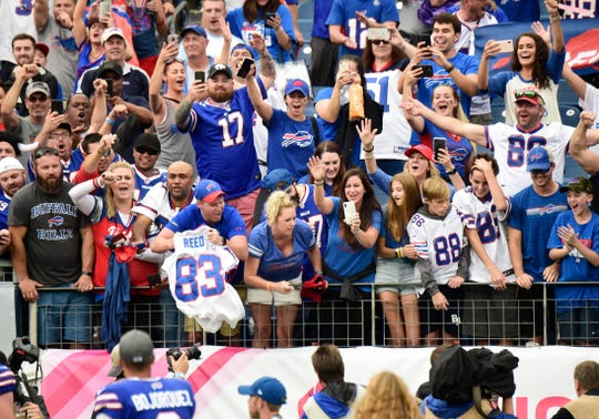 Buffalo Bills fans celebrate after the team's 14-7 win over the Tennessee Titans during the game at Nissan Stadium Sunday, Oct. 6, 2019 in Nashville, Tenn.