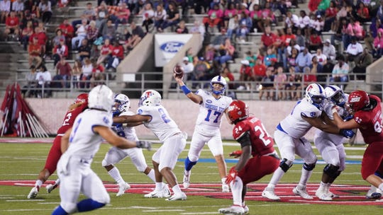 Tennessee State quarterback Cameron Rosendahl (17) throws the ball to Chris Rowland (3) in Saturday night's game at Jacksonville State.