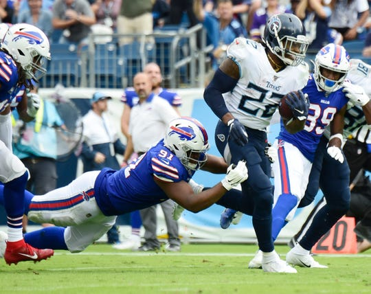 Tennessee Titans running back Derrick Henry (22) rushes for a first down during the third quarter of the game at Nissan Stadium Sunday, Oct. 6, 2019 in Nashville, Tenn.