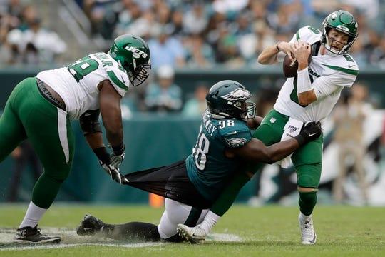 Philadelphia Eagles' Hassan Ridgeway (98) tries to tackle New York Jets' Luke Falk (8) as Kelvin Beachum (68) defends during the second half of an NFL football game, Sunday, Oct. 6, 2019, in Philadelphia. (AP Photo/Matt Rourke)
