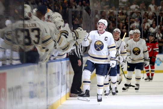 Buffalo Sabres center Jack Eichel (9) celebrates after scoring a goal in the first period of an NHL hockey game against the New Jersey Devils, Saturday, Oct. 5, 2019, in Buffalo, N.Y.