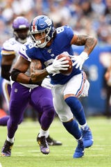 New York Giants tight end Evan Engram (88) rushes against the Minnesota Vikings in the second half. The New York Giants lose to the Minnesota Vikings, 28-10, in NFL Week 5 on Sunday, Oct. 6, 2019, in East Rutherford.