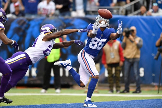 New York Giants wide receiver Darius Slayton (86) makes a touchdown catch against the Minnesota Vikings in the first half. The New York Giants face the Minnesota Vikings in NFL Week 5 on Sunday, Oct. 6, 2019, in East Rutherford.