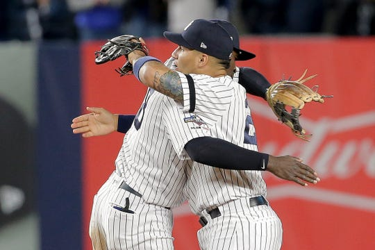 New York Yankees second baseman Gleyber Torres (25) and shortstop Didi Gregorius (18) celebrate after the Yankees beat the Minnesota Twins 8-2 in Game 2 of an American League Division Series Saturday, Oct. 5, 2019, in New York.