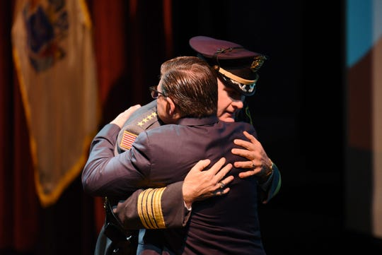 Morris County Sheriff James M. Gannon, hugs Assemblyman Anthony M. Bucco after his speech during a public remembrance of the life of state Sen. Anthony R. Bucco, held at County College of Morris in Randolph on 10/09/19.  The Senator died Sept. 16 at 81 years old.