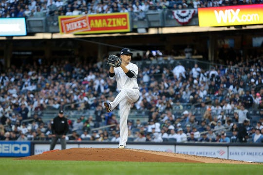 Oct 5, 2019; Bronx, NY, USA; New York Yankees starting pitcher Masahiro Tanaka (19) throws against the Minnesota Twins during the second inning of game two of the 2019 ALDS playoff baseball series at Yankee Stadium.