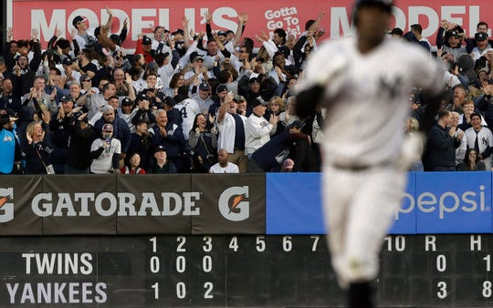 Baseball fans react after a grand slam home run by New York Yankees' Didi Gregorius during the third inning of Game 2 of an American League Division Series baseball game against the Minnesota Twins, Saturday, Oct. 5, 2019, in New York.