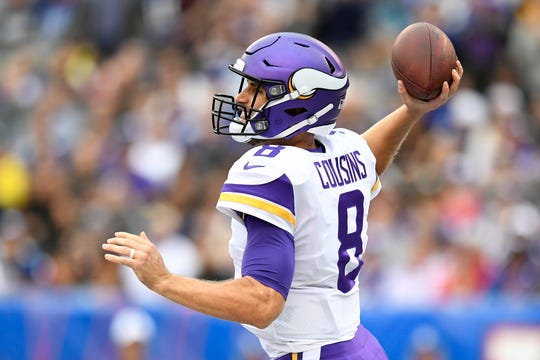 Minnesota Vikings quarterback Kirk Cousins (8) throws against the New York Giants in the first half. The New York Giants face the Minnesota Vikings in NFL Week 5 on Sunday, Oct. 6, 2019, in East Rutherford.