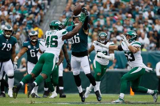 Philadelphia Eagles' Zach Ertz, center, cannot catch a pass against New York Jets' Neville Hewitt, left, and Blake Cashman during the first half of an NFL football game, Sunday, Oct. 6, 2019, in Philadelphia. (AP Photo/Michael Perez)