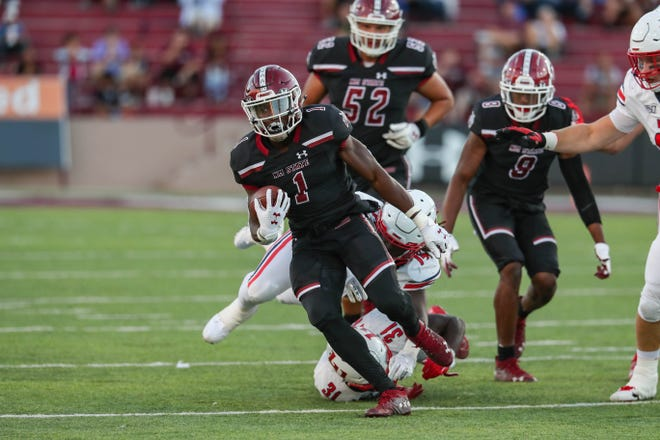 NMSU senior running back Jason Huntley (1) runs the ball as the New Mexico State University Aggies face off against the Liberty University Flames at Aggie Memorial Stadium in Las Cruces on Saturday, Oct. 5, 2019.