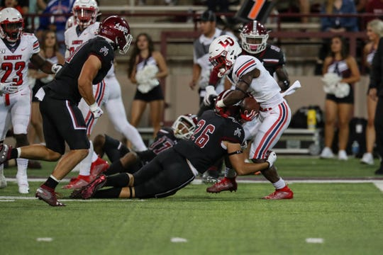 Freshman wide receiver Shedro Louis (1) receives and runs the ball as the New Mexico State University Aggies face off against the Liberty University Flames at Aggie Memorial Stadium in Las Cruces on Saturday, Oct. 5, 2019.