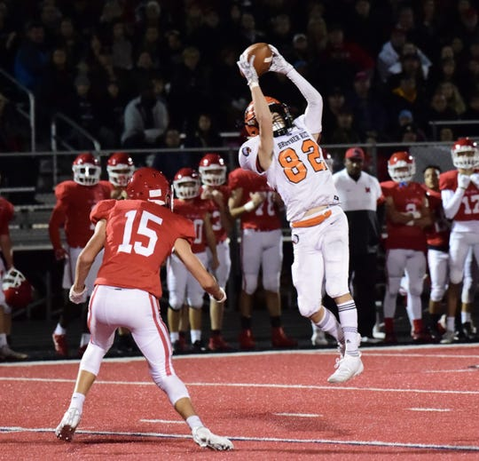 Brother Rice wide receiver Cole Lacanaria catches a touchdown pass from quarterback Greg Piscopink. Brother Rice falls to Orchard Lake St. Mary's 44-21 on Oct. 5.