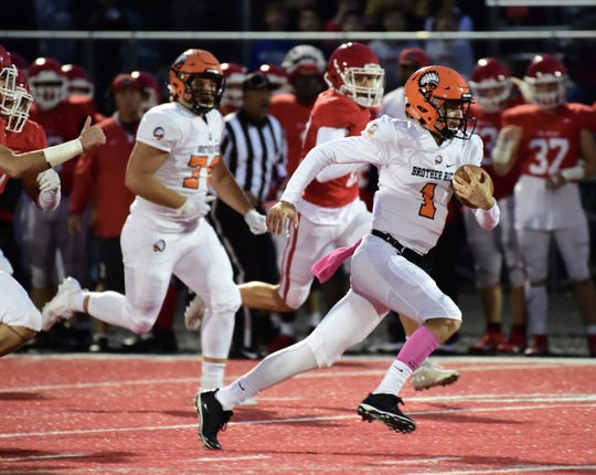 Brother Rice quarterback Greg Piscopink finds open space in the run game. Brother Rice falls to Orchard Lake St. Mary's 44-21 on Oct. 5.