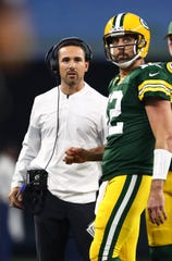 Oct 6, 2019; Arlington, TX, USA;  Green Bay Packers quarterback Aaron Rodgers (12) and head coach Matt LaFleur look at the scoreboard during a timeout in the second quarter against the Dallas Cowboys at AT&T Stadium.