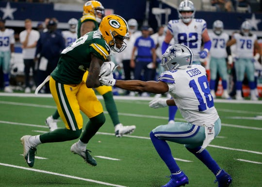 Green Bay Packers defensive back Chandon Sullivan (39) intercepts a Dallas Cowboys' Dak Prescott pass in front of wide receiver Randall Cobb (18) in the first half of an NFL football game in Arlington, Texas, Sunday, Oct. 6, 2019.